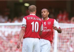 Thierry Henry celebrates scoring with Dennis Bergkamp