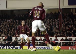 Thierry Henry delfects a shot by Robert Pires into the goal for Arsenal's 1st goal