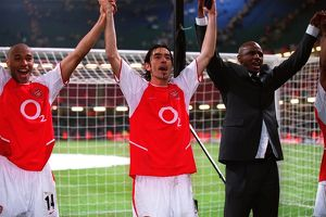 Thierry Henry, Robert Pires and Patrick Vieira (Arsenal) celebrate at the end of the match