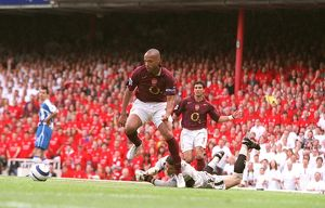 Thierry Henry scores Arsenal's 3rd goal his 2nd as he rounds Mike Pollitt (Wigan)