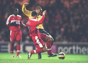 Thierry Henry shoots past Andrew Taylor and Middlesbrough goalkeeper Brad Jones to score the Arsenal goal. Middlesbrough 1:1 Arsenal, The Premiership, The Riverside Stadium, Middlesbrough, 3/2/2007. Credit: Stuart MacFarlane / Arsenal