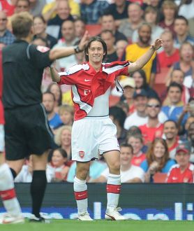 Tomas Rosicky (Arsenal) shows the referee his torn shirt