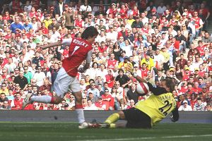 Tomas Rosicky shoots past Bolton goalkeeper Jussi Jaskelainen to score the first Arsenal goal